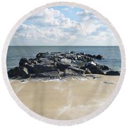 Icy Rocks And Blowing Snow Round Beach Towel