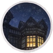 Illuminated Windows Of A Turret In A Timber Framed Tudor House Round Beach Towel