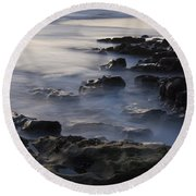 In The Fading Light Round Beach Towel