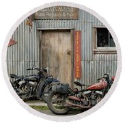 Indian Chout And Chief Bobber At The Old Okains Bay Garage Round Beach Towel