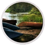 Kayaks On The Shore Round Beach Towel