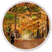 Kid With Backpack Walking In Fall Colors Round Beach Towel
