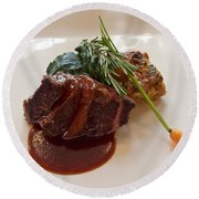 Kobe Beef With Spring Spinach And A Wild Mushroom Bread Pudding Round Beach Towel
