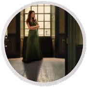 Lady In Green Gown By Window Round Beach Towel