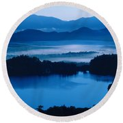 Lake And Moor In Mist Round Beach Towel