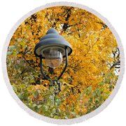 Lamp In The Autumn Leaves Round Beach Towel