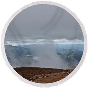 Land And Clouds Converge Round Beach Towel