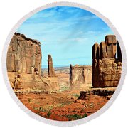 Land Of The Giants Round Beach Towel
