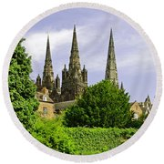 Lichfield Cathedral From The Garden Round Beach Towel