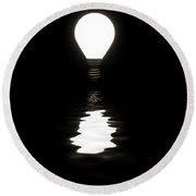 Light Bulb Shining With Reflection In Water On Black Round Beach Towel