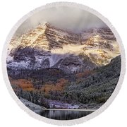 Light On Maroon Bells Round Beach Towel