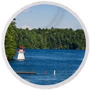 Lighthouse And Boathouse Round Beach Towel