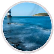 Lighthouse At Penmon Point Round Beach Towel