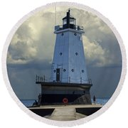Lighthouse At The End Of The Pier In Ludington Michigan Round Beach Towel