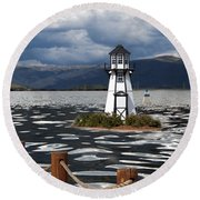 Lighthouse In Lake Dillon Round Beach Towel