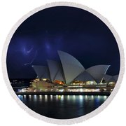 Lightning Behind The Opera House Round Beach Towel