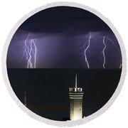 lightnings over Genova Round Beach Towel