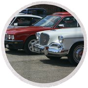 A Line Up Of Vintage Cars Round Beach Towel