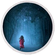 Little Girl In Red Dress Running In A Misty Forest Round Beach Towel