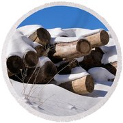 Log Pile In A Snow Drift In Winter Round Beach Towel