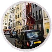 London Taxi On Shopping Street Round Beach Towel by Elena Elisseeva