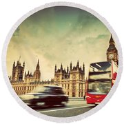 London The Uk Red Bus Taxi Cab In Motion And Big Ben Round Beach Towel