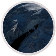 Lone Alpinist Silhouetted On Heavily Round Beach Towel