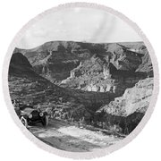 Lone Car In Fish Creek Canyon Round Beach Towel