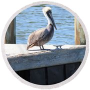 Lone Pelican On Pier Round Beach Towel