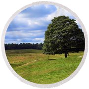 Lone Tree On Grassy Knoll Round Beach Towel