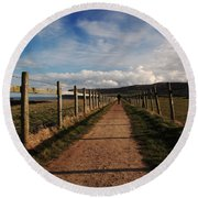 Lone Walker On The North Yorkshire Coastal Path Round Beach Towel