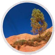 Lonely Pine On The Ocher Hill Round Beach Towel