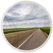 Road To The Sky In Saskatchewan. Round Beach Towel
