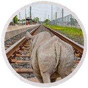 Rhino On A Railway Track Round Beach Towel