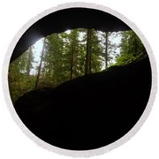 Looking Outside Boulder Cave Round Beach Towel