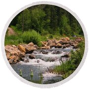 Looking Up The Rapids Round Beach Towel