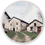 Low Angle View Of Houses In A Village Round Beach Towel
