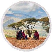Maasai Men Sitting. Savannah Landscape In Tanzania Round Beach Towel