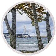 Mackinaw Bridge In Autumn By The Straits Of Mackinac Round Beach Towel