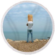 Man By The Sea With Bag On His Head Round Beach Towel