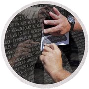 Man Getting A Rubbing Of Fallen Soldier's Name At The Vietnam War Memorial Round Beach Towel