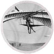 Man Gliding In 1883 Round Beach Towel