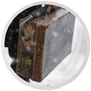 Man Holding A Vintage Leather Suitcase In Winter Snow Round Beach Towel
