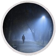 Man In Hat And Overcoat Walking In Fog On A Tree Lined Avenue In Round Beach Towel