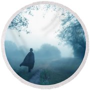 Man In Top Hat And Cape On Foggy Dirt Road Round Beach Towel