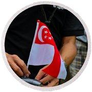 Man Plants Singapore Flag On Bicycle Round Beach Towel