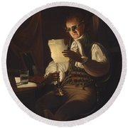 Man Reading By Candlelight Round Beach Towel