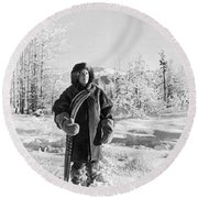 Man With Parka And Snowshoes Round Beach Towel