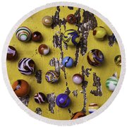 Marbles On Yellow Wooden Table Round Beach Towel