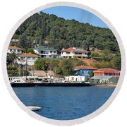 Marina Bay Scene With Boat And Houses On Hills Round Beach Towel